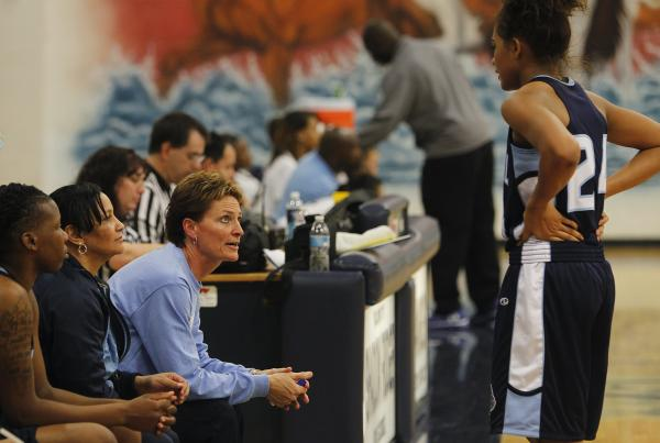 Centennial girls basketball coach Karen Weitz offers some individual instruction to one of the Bulldogs' players during a game against Shadow Ridge. Weitz has 503 career wins.
