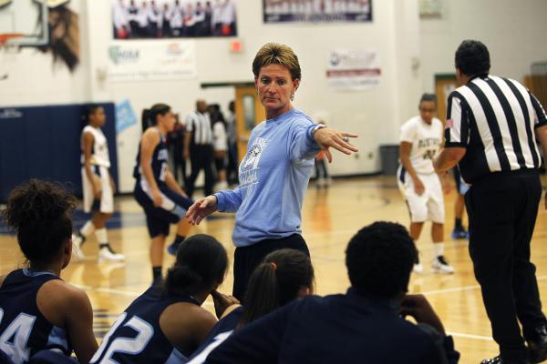 Centennial girls basketball coach Karen Weitz walks the sidelines during her team's game against Shadow Ridge.