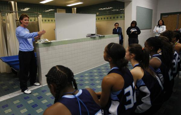 Centennial coach Karen Weitz instructs her team during halftime of their game against Shadow Ridge. Weitz has won 503 career games as a high school basketball coach.