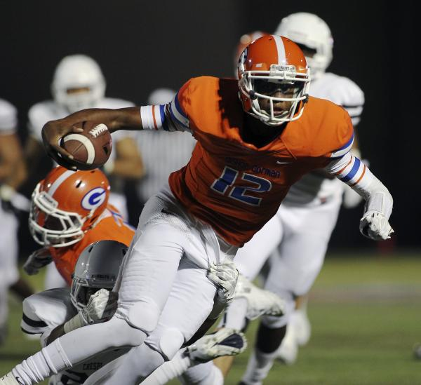 Bishop Gorman quarterback Randall Cunningham, seen carrying the ball against Crespi (Calif.) earlier this season, has passed for 1,662 yards and rushed for 1,211 yards this season. He'll lead the  ...