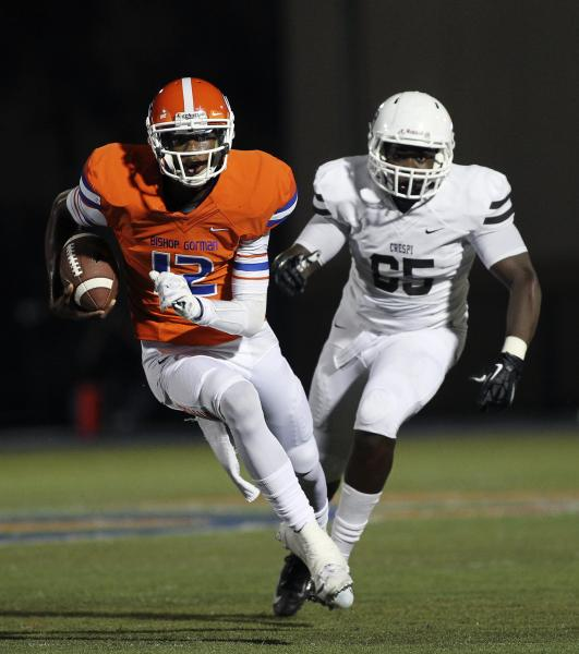 Bishop Gorman quarterback Randall Cunningham (12) runs past Crespi's Matthew Orozco on Friday. The Gaels rushed for 367 yards in a 42-9 win.