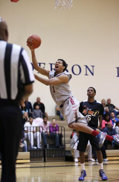 Findlay Prep's Rashad Vaughn (1) takes a shot as PHASE 1 Academy's Reece Brooks (15) looks on during Saturday's game at Henderson International.