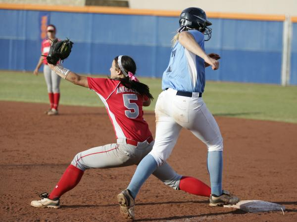 Arbor View's Kellie Anderson, left, stretches to take a throw and force out Taylor Huntly in the third inning on Wednesday in the Sunset Region softball tournament at Bishop Gorman.