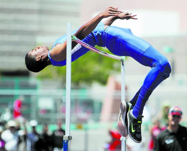 Bishop Gorman's Randall Cunningham clears 7 feet, 3¼ inches to win the state high jump title on May 18. The senior made an oral commitment to attend Southern California.