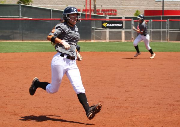 Centennial's Mia Acuna, left, runs to third base, and teammate Heather Bowen heads to second base.