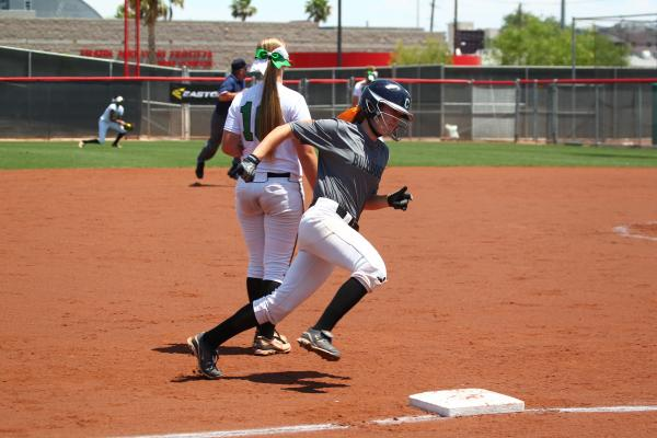 Centennial's Alyssa Finger prepares to round third base and score the Bulldogs' fourth run of the first inning.