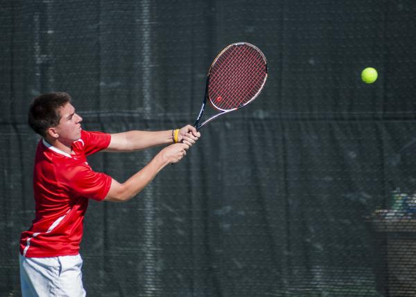 Tech's Christian Valle reaches for a backhand.