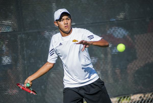 Clark sophomore Miko Pasimio returns a volley during the NIAA Division I-A state singles boys championship match on Oct. 26 at Bishop Gorman's tennis courts. Pasimio, who captured the singles ti ...