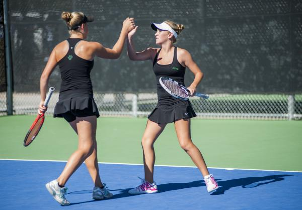 Palo Verde's Chloe Henderson, left, and Sophie Henderson celebrate in the girls doubles final.