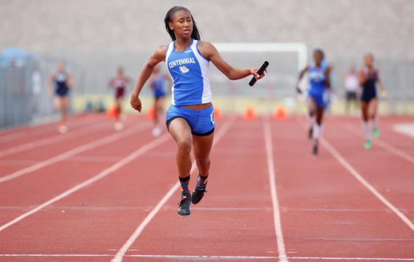 Centennial's Tamera Williams crosses the finish line as the Bulldogs win the 800-meter relay on Friday in the Sunset Region championships. Centennial won nine of 10 contested events on Friday to c ...