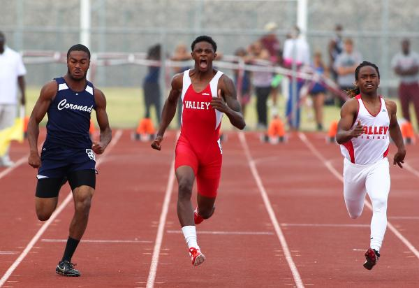 Valley's Arphaxad Carroll, center, sets the paced in the 100-meter dash Friday during the Division I sunrise Region championships at Silverado. He placed first in 10.81 seconds.