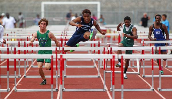 Canyon springs' Demarcus Walker takes th lead in the Sunrise Region boys 110-meter hurdles. Walker won the event in 15.22 seconds.
