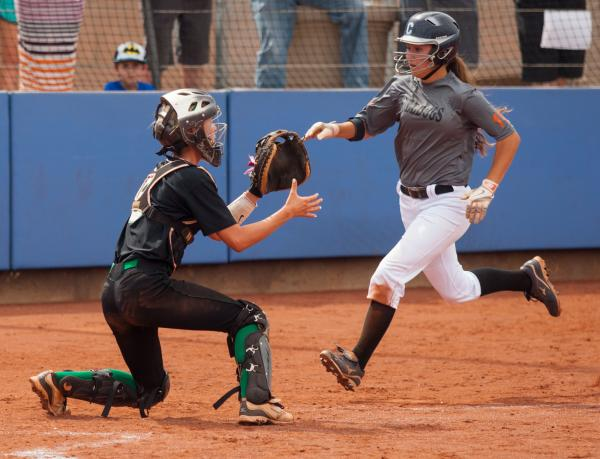 Centennial's Mia Acuna scores a first-inning run as Palo Verde catcher Brooke Stover awaits a throw on Friday in the Sunset Region title game. The Bulldogs topped the Panthers, 13-3.