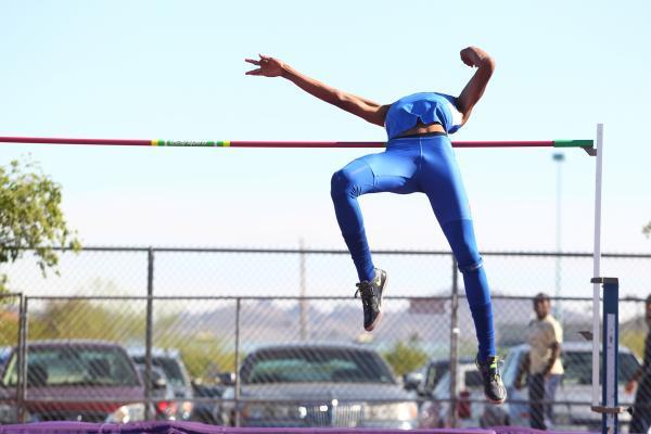 Bishop Gorman's Randall Cunningham clears 7 feet in the Sunset Region boys high jump