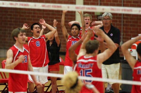 Valley players react after winning a point against Silverado