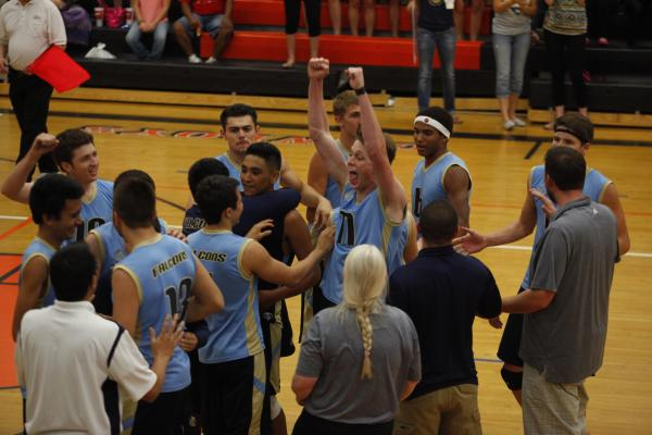 Foothill's Caleb Hutchinson, center, celebrates with his team after defeating Palo Verde