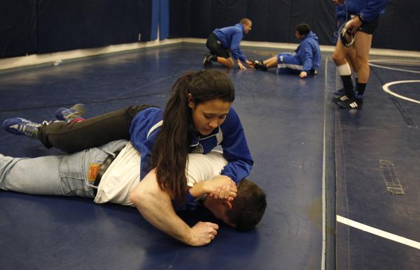 Sierra Vista wrestler Caroline Sauder warms up with Daniel Strbac before a dual meet at Sierra Vista on Wednesday.