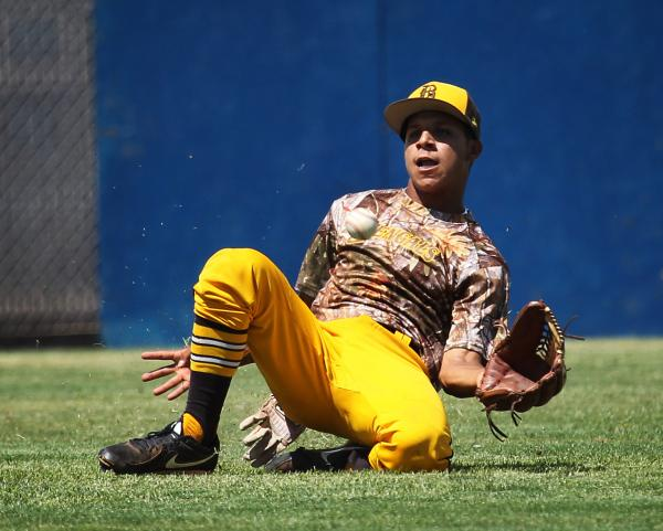 Bonanza center fielder Daniel Romero slides to make a catch during the fifth inning on Friday against Bishop Gorman. The Bengals rallied for five runs in the sixth inning to earn an 8-5 win for th ...