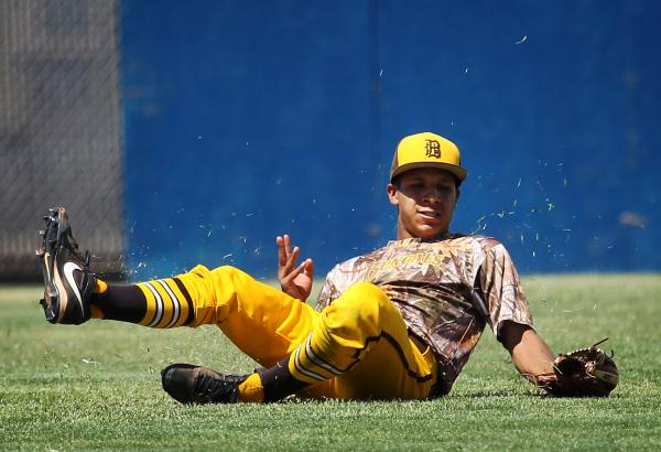 Bonanza center fielder Daniel Romero makes a sliding catch during the fifth inning Friday against Bishop Gorman. Romero and the Bengals rallied for an 8-5 win in the Sunset Region championship game.