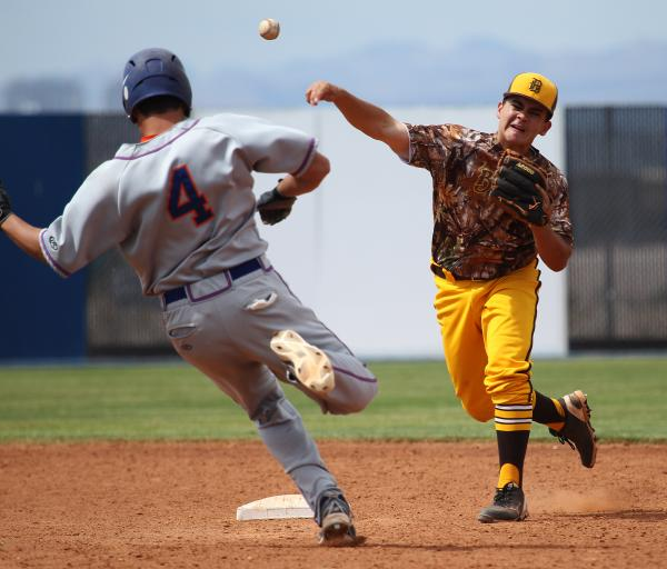 Bonanza second baseman Sean DeSoto tries to complete a double play as Bishop Gorman pinch-runner Brandon Wulff slides into second in the seventh inning of the Sunset Region title game on Friday.
