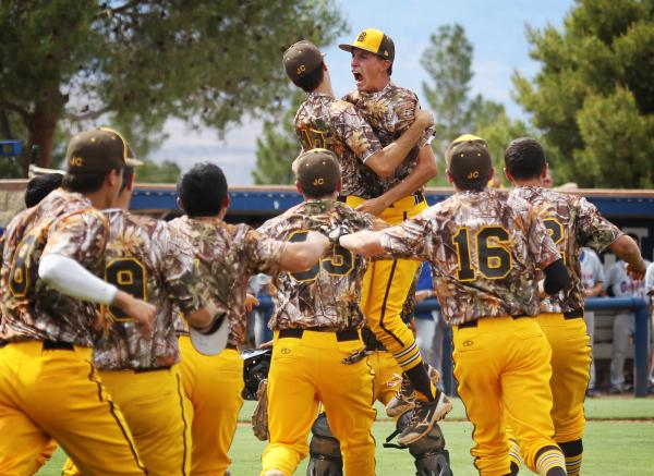 Bonanza reliever Dave Estrada gets mobbed by his teammates after recording the final out in an 8-5 win over Bishop Gorman in the Sunset Region title game.