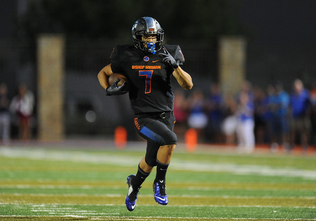 Bishop Gorman running back Biaggio Walsh scores a  touchdown against Chandler, AZ in the first quarter of their high school football game at Bishop Gorman High School in Las Vegas Saturday, Aug. 2 ...