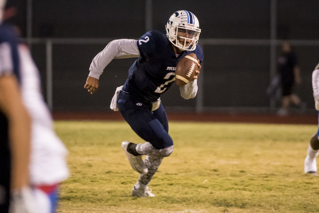 Centennial Bulldogs quarterback Jamaal Evans (2) runs with the ball against the Liberty Patriots at Carol Leavitt Stadium in Las Vegas on Friday, Sept. 18, 2015. Joshua Dahl/Las Vegas Review-Journal