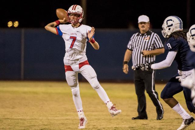 Liberty Patriots quarterback Kenyon Oblad (7) throws the ball against the Centennial Bulldogs at Carol Leavitt Stadium in Las Vegas on Friday, Sept. 18, 2015. Joshua Dahl/Las Vegas Review-Journal