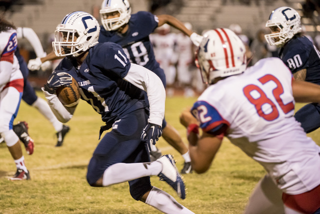 Centennial Bulldogs receiver Savon Scarver (11) runs with the ball against the Liberty Patriots at Carol Leavitt Stadium at Centennial High School in Las Vegas on Friday, Sept. 18, 2015. Joshua Da ...