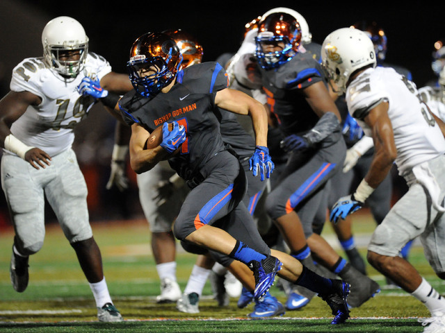 Bishop Gorman running back Biaggio Walsh (7) rushes the ball against Long Beach Poly  in the first half during their prep football game at Bishop Gorman High School in Las Vegas Friday, Sept. 18 2 ...