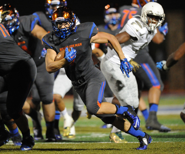 Bishop Gorman running back Biaggio Walsh (7) rushes the ball for a first down in the first half during their prep football game against Long Beach Poly at Bishop Gorman High School in Las Vegas Fr ...
