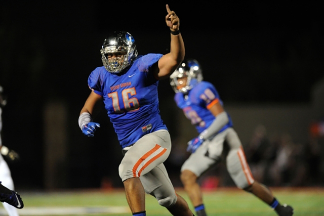 Bishop Gorman defensive lineman Haskell Garrett (16) celebrates a Gorman fumble recovery against Servite in the second half Bishop Gorman High School in Las Vegas Friday, Sept. 25, 2015. Bishop Go ...