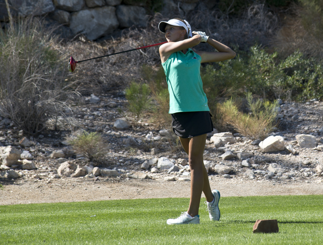 Annick Haczkiewicz, of Palo Verde High School, hits her ball during the Sunset Region golf tournament at Red Rock Country Club on Monday, Oct. 12, 2015. Daniel Clark/Las Vegas Review Journal