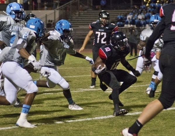Las Vegas' Elijah Hicks (10) runs the ball up the field during their prep football game against Canyon Springs High School at Las Vegas High School on Friday, Oct. 16, 2015. Daniel Clark/Las Vegas ...