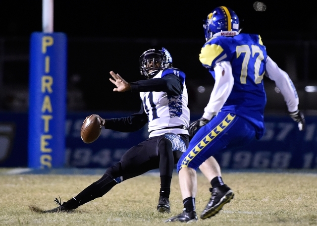 Desert Pines quarterback Marckell Grayson (11) looks to pass against Moapa Valley's Larson Love during a high school football game at Moapa Valley High School in Overton on Friday, Nov. 6, 2015. D ...