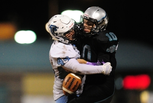Silverado quarterback Micah Weber fumbles as Foothill linebacker Kealil Maruyama (44) tackles him during their prep football game at Silverado High School in Henderson Friday, Nov. 13, 2015. Josh  ...