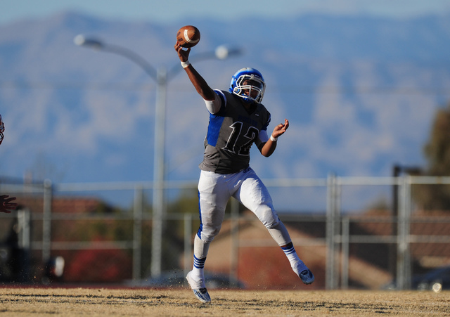 Basic Wolves quarterback Aaron McAllister passes against Liberty in the second half of the NIAA Division 1 Sunrise Region Football Final prep football game  at Basic High School in Henderson  Satu ...