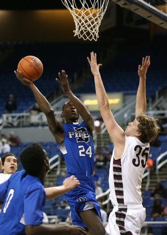 Desert Pines' Nate Grimes, seen shooting over Elko defender Brian Pearson during a Division I-A state tournament, is considered one of the hottest prospects in the West. (Cathleen Allison/Las Vega ...