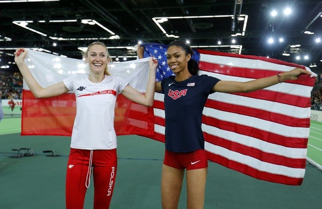 Bronze medal winner Kamila Licwinko of Poland (L) and gold medal winner Vashti Cunningham of the U.S. celebrate after the women's high jump during the IAAF World Indoor Athletics Championships in  ...