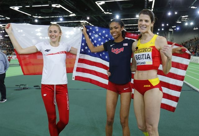 Bronze medal winner Kamila Licwinko of Poland, gold medal winner Vashti Cunningham of the U.S. and silver medalist Ruth Beitia (R) celebrate after the women's high jump during the IAAF World Indoo ...