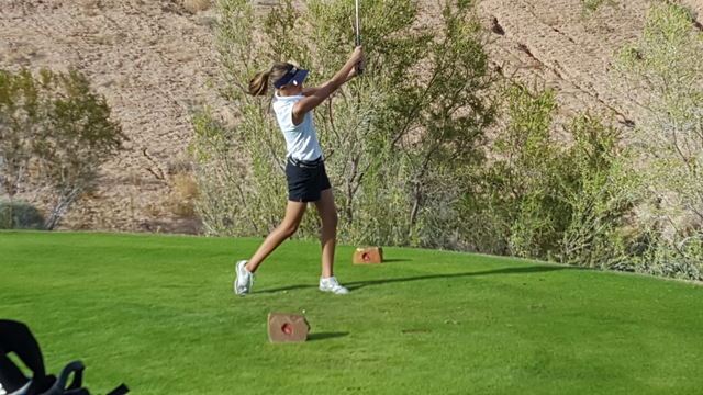 Boulder City's Ryann Reese tees off on the 14th hole during the Class 3A Southern Region girls golf tournament on Thursday at Falcon Ridge Golf Course in Mesquite. Reese shot a career-best 99 to h ...