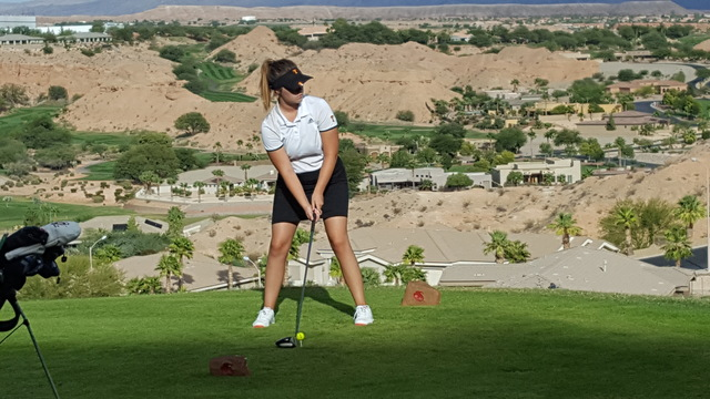 Tech's Scout Pope prepares to hit her drive on the 16th tee during the Class 3A Southern Region girls golf tournament on Thursday at Falcon Ridge Golf Course in Mesquite. Pope shot 88 to and finis ...