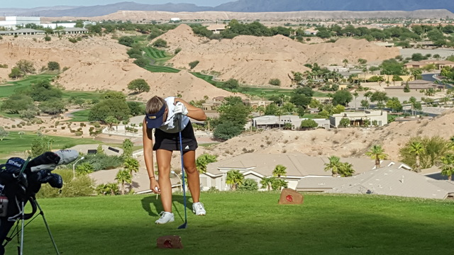 Lani Potter of Boulder City tees up her ball on the 16th hole during the Class 3A Southern Region girls golf tournament on Thursday at Falcon Ridge Golf Course in Mesquite. Potter shot 3-over-par  ...