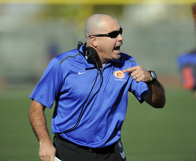 Bishop Gorman head coach Tony Sanchez shouts instructions during their Division I state football semifinal game against Liberty at Rancho on Saturday. Bishop Gorman defeated Liberty 50-0. (Josh Ho ...