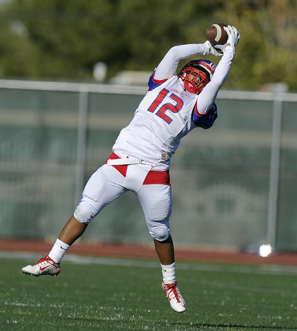 Liberty wide receiver Brad Viloria (12) catches a pass against Bishop Gorman in the the Division I state football semifinal game at Rancho on Saturday. Bishop Gorman defeated Liberty, 50-0. (Josh  ...
