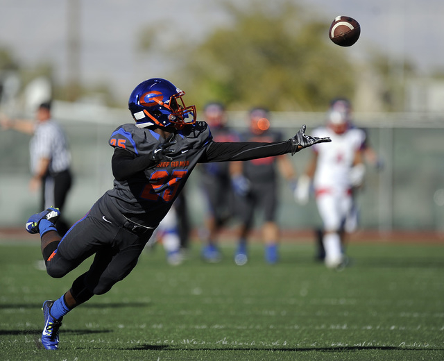 Bishop Gorman wide receiver cornerback Tyjon Lindsey (25) is unable to make a reception against Liberty in the first half of their Division I state football semifinal game at Rancho High School on ...