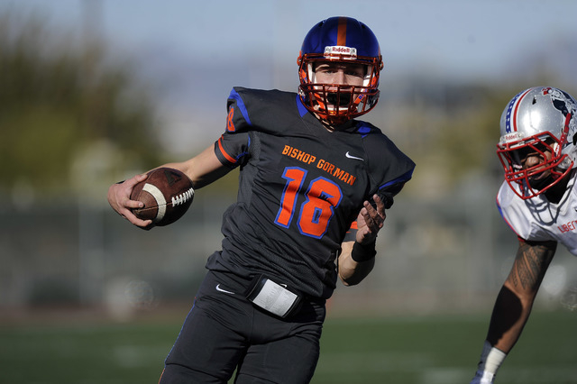 Bishop Gorman quarterback Tate Martell (18) rushes for a touchdown in the first half of the Division I state football semifinal game against Liberty at Rancho on Saturday. Martell rushed for three ...