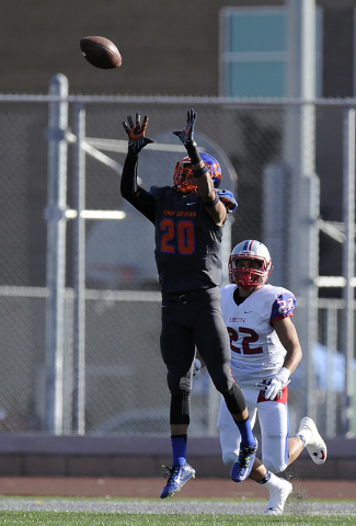 Bishop Gorman cornerback Jabari Butler (20) intercepts a pass intended for Liberty wide receiver Jameson Pasigan (22) in the first half of the Division I state football semifinal game at Rancho on ...