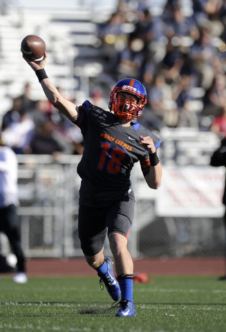 Bishop Gorman quarterback Tate Martell (18) throws a pass in the first half of the Division I state football semifinal game against Liberty at Rancho High School on Saturday, Nov. 29, 2014. (Josh  ...