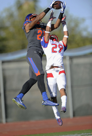 Liberty defensive back Jake Dedeaux (29) breaks up a pass intended for Bishop Gorman wide receiver Cordell Broadus (21) in the end zone during the first half of the Division I state football semif ...